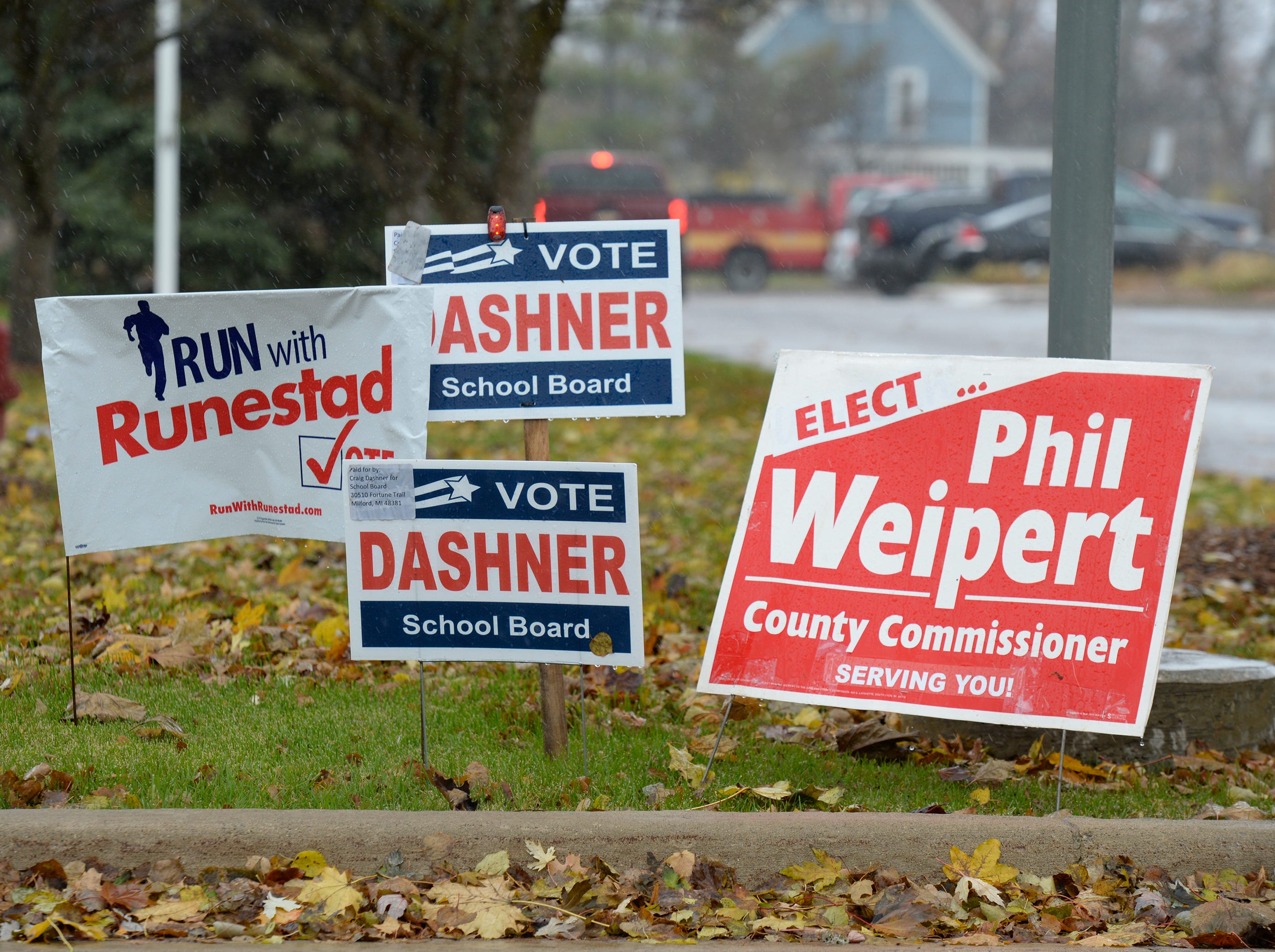 Yards signs outside South Lyon City Hall on election day Nov. 6, 2018.