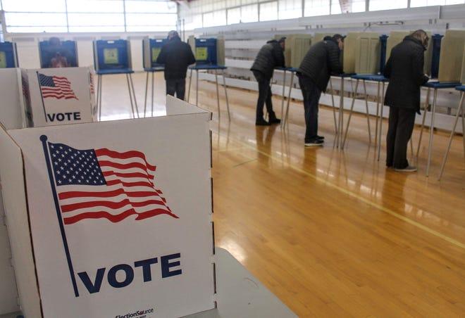 Voters cast their ballots inside Derby Middle School in Birmingham.