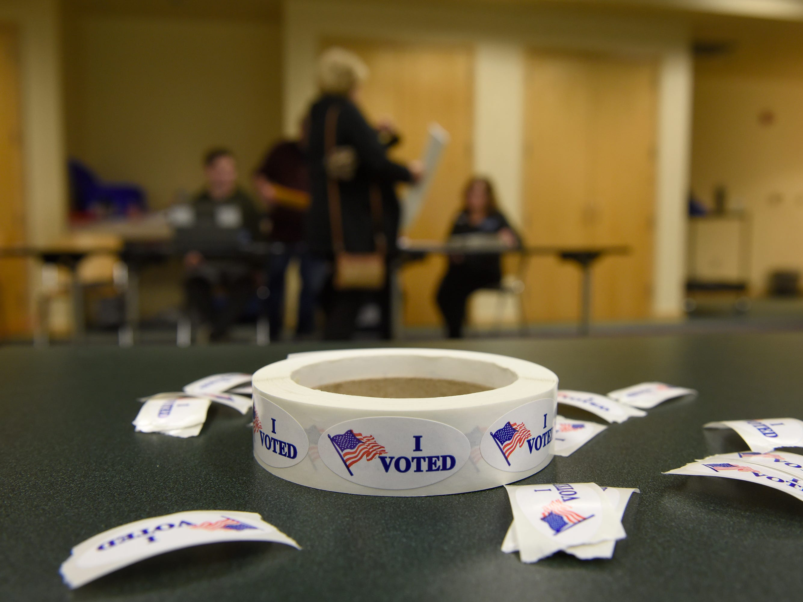 Stickers wait for voters at the Milford Library on election day Nov. 6, 2018.