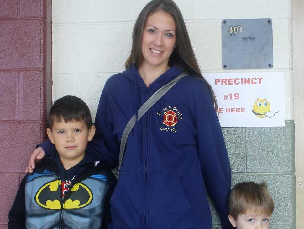 Elise Burton brought her two young children to Plymouth High School to vote.