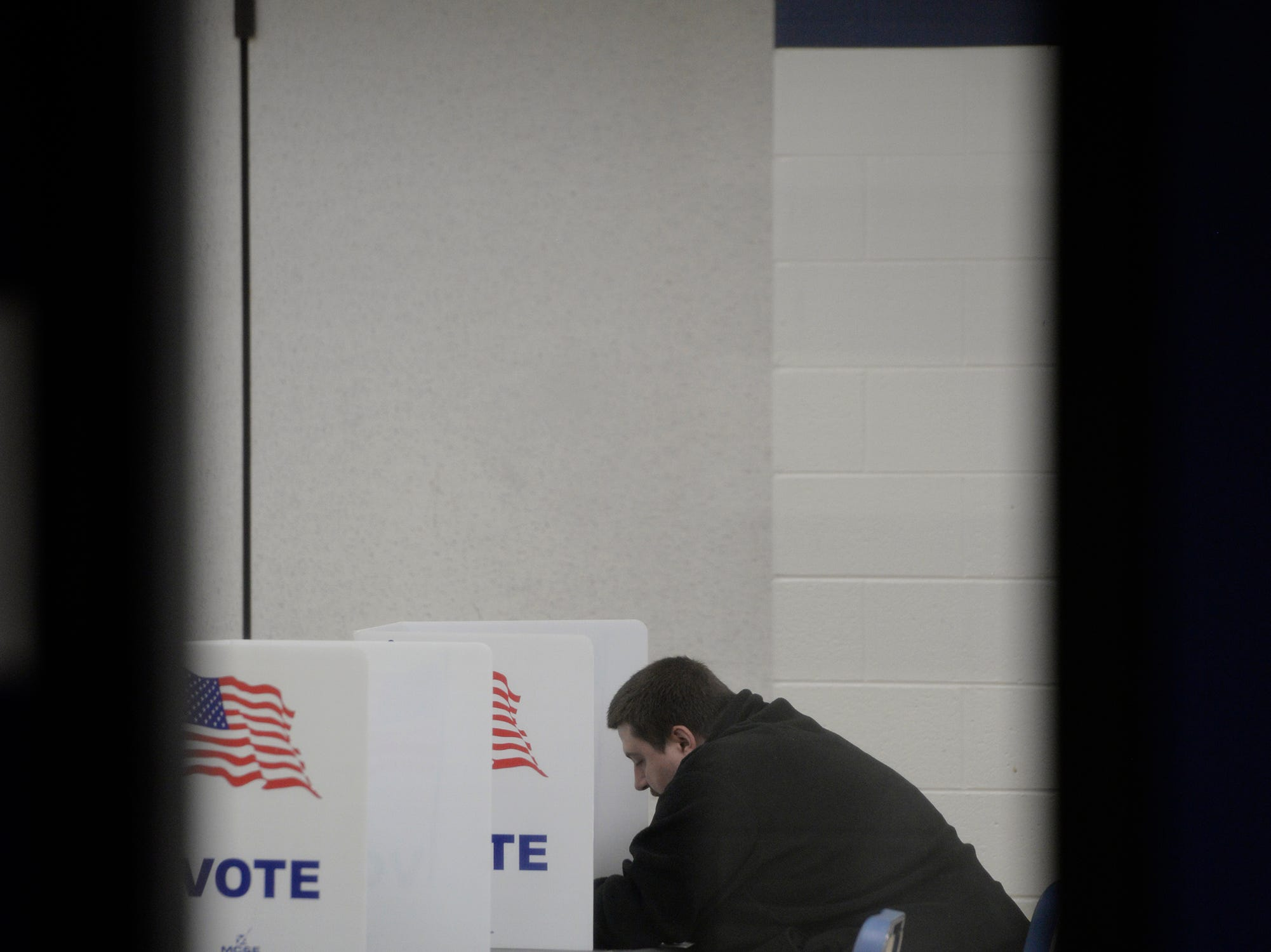 Carl Daisy II fills out his ballot at farmington High School on election day Nov. 6, 2018.