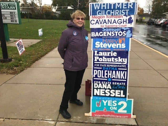 Doris VanVuren campaigns for the Democratic slate outside Grant Elementary School in Livonia.