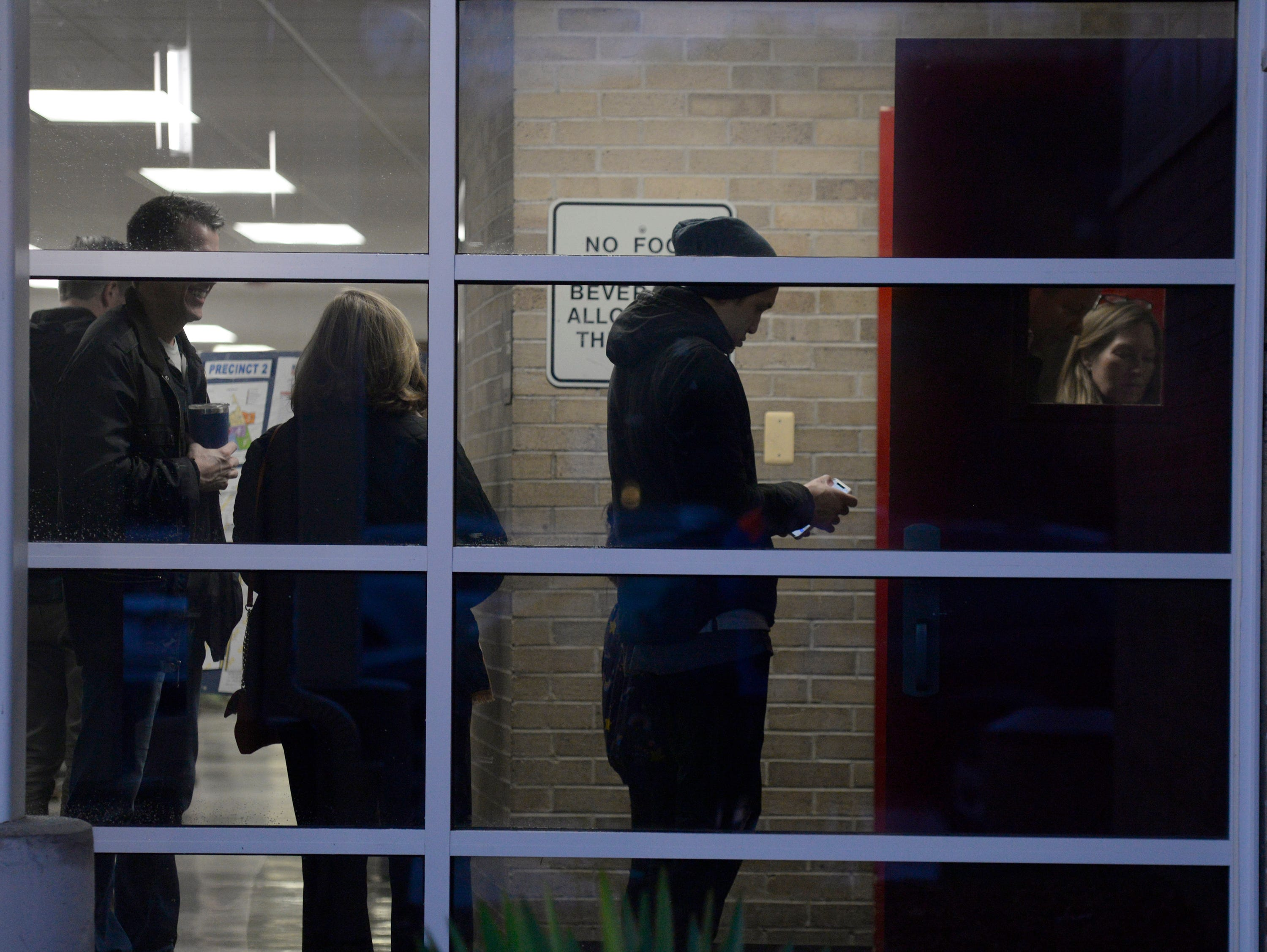 Voters wait in line at Derby Middle School in Birmingham early on election day Nov. 6, 2018.