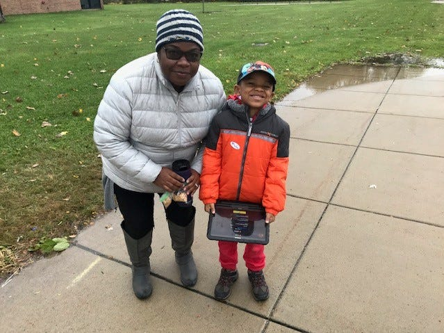 Voter Angela Montgomery brought her 6-year-old son, Parker, with her to the polls, teaching him early the importance of voting. She voted at Grant Elementary School in Livonia.