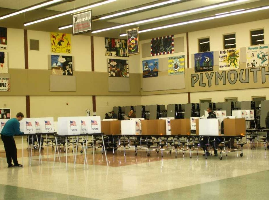 People vote in the Plymouth High School cafeteria.