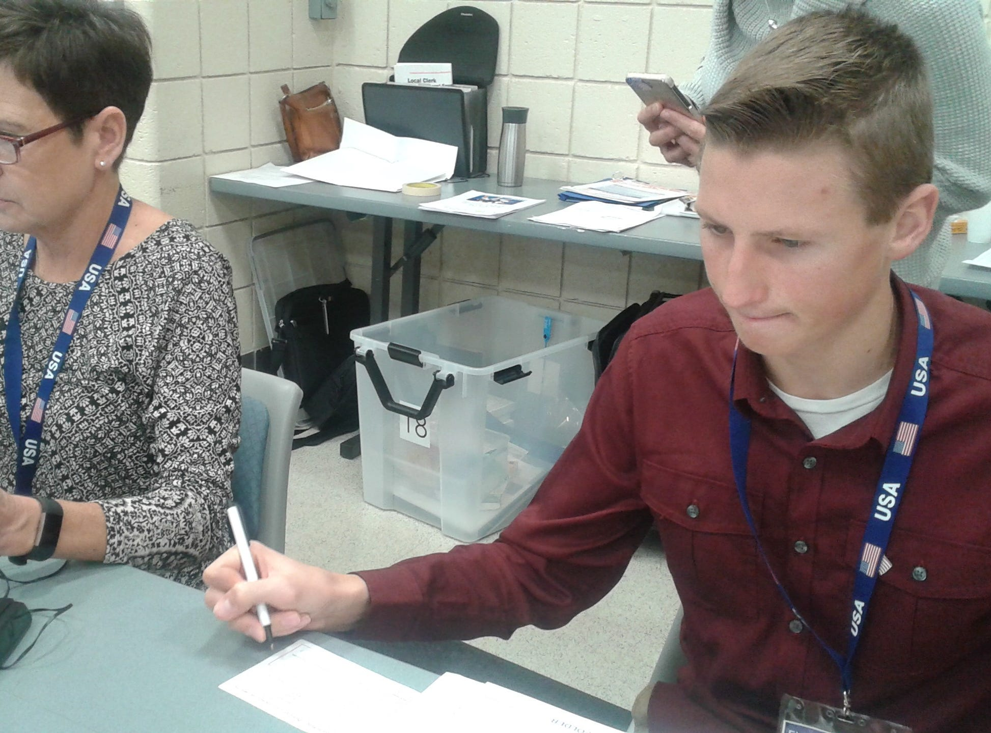 Gail Mazuchowski and Trey Mullins work precinct #18 at the Novi Municipal Center.