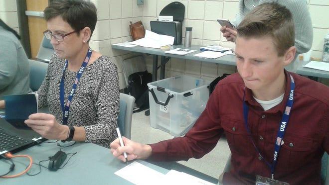 Gail Mazuchowski and Trey Mullins work precinct #18 at the Novi Municipal Center.