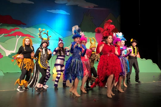 """Mayzie (the red bird, played by Riley Courter) and the ensemble in """"Seussical,"""" being produced this weekend at Franklin High School."""