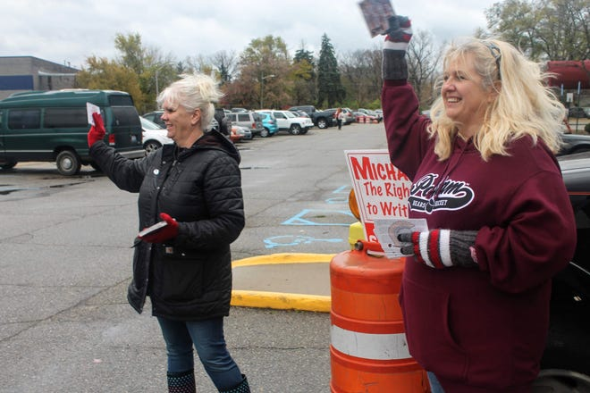 Kristine Baer, left, of Farmington Hills, along with Debbie Grefke of Livonia, campaign for Michael Liss, a write-in candidate running for the Clarenceville school board. Clarenceville schools cover part of Farmington Hills, Livonia and Redford Township.