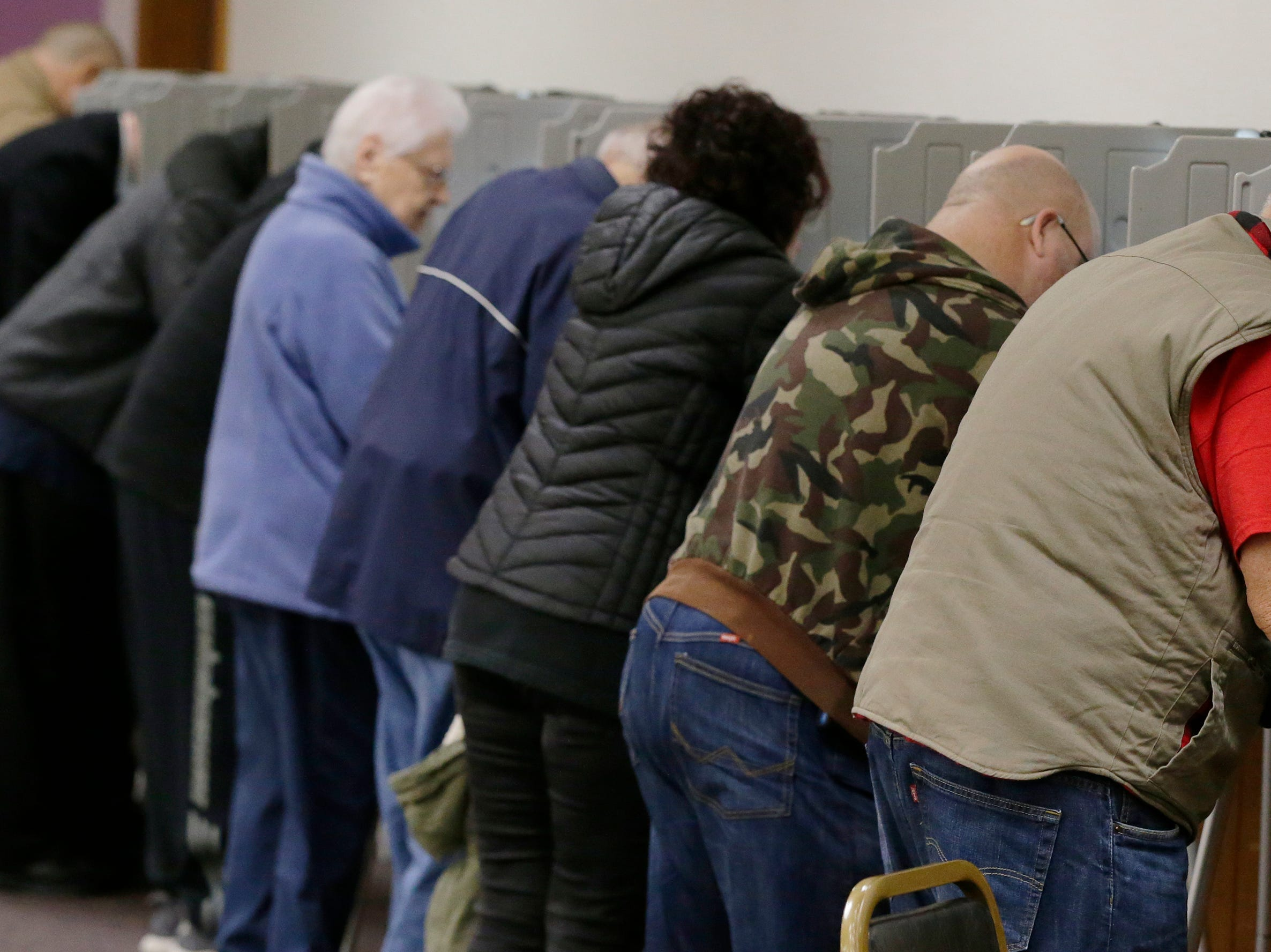 The mid-term voting keeped poll workers busy as voters waited in lines at most polling stations in Oshkosh, Wis., Tuesday, November 6, 2018.  