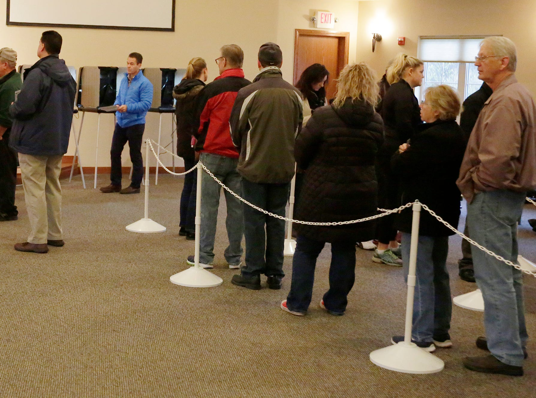 When the polls opened up at 7 a.m. there were long lines waiting to vote at voting district 10 at Living Water Lutheran Church. The mid-term voting kept poll workers busy as voters waited in lines at most polling stations in Oshkosh, Wis., Tuesday, November 6, 2018.  