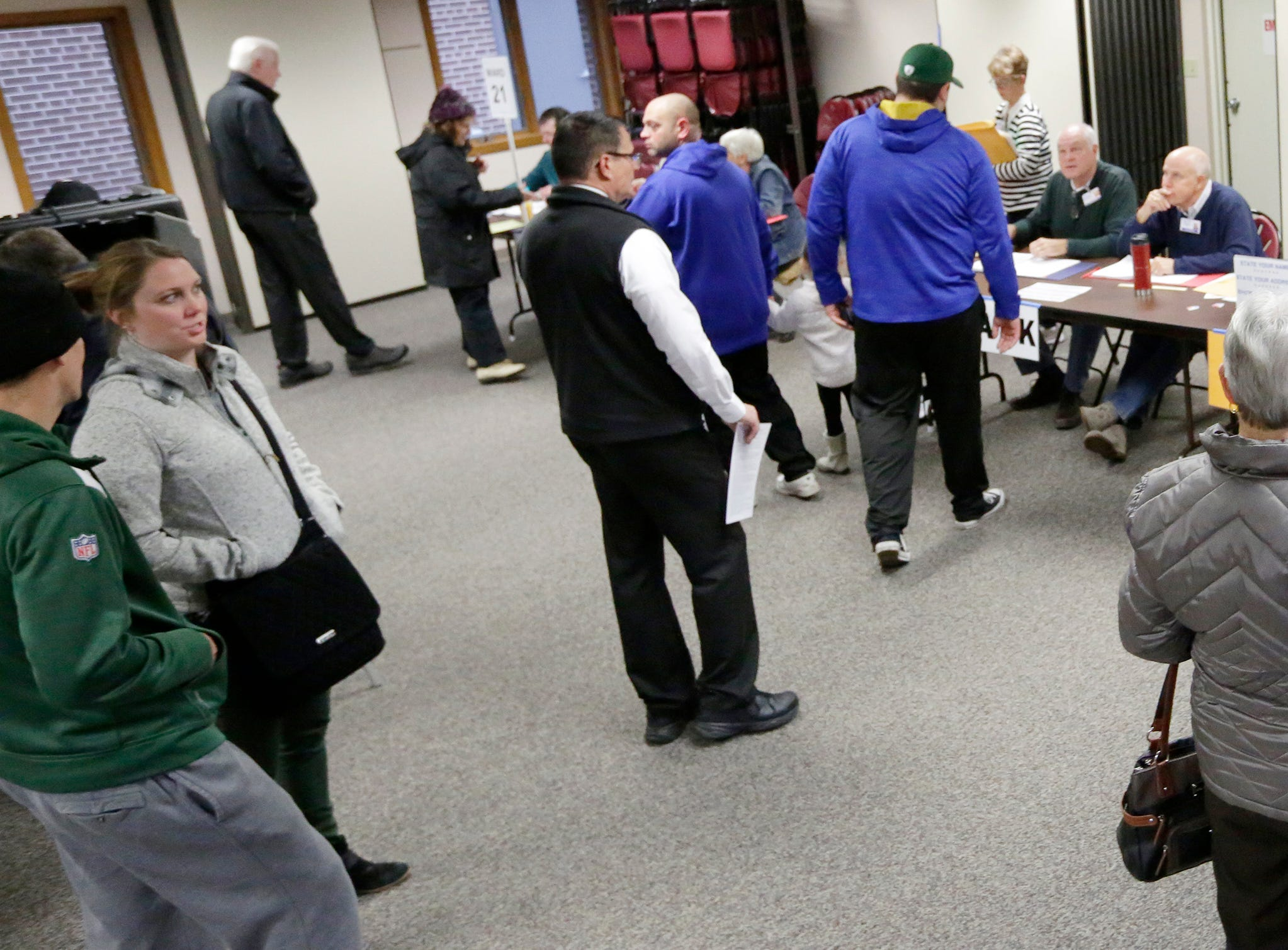 Voters wait in line at voting district 10 at Calvary Lutheran Church.  The mid-term voting kept poll workers busy as voters waited in lines at most polling stations in Oshkosh, Wis., Tuesday, November 6, 2018.  