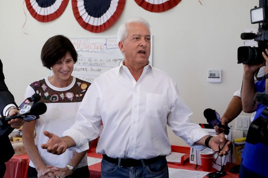 California Republican gubernatorial candidate John Cox speaks during campaign stop as Rep. Mimi Walters, R-Calif., looks on, Tuesday, Nov. 6, 2018, in Irvine, Calif. (AP Photo/Chris Carlson)