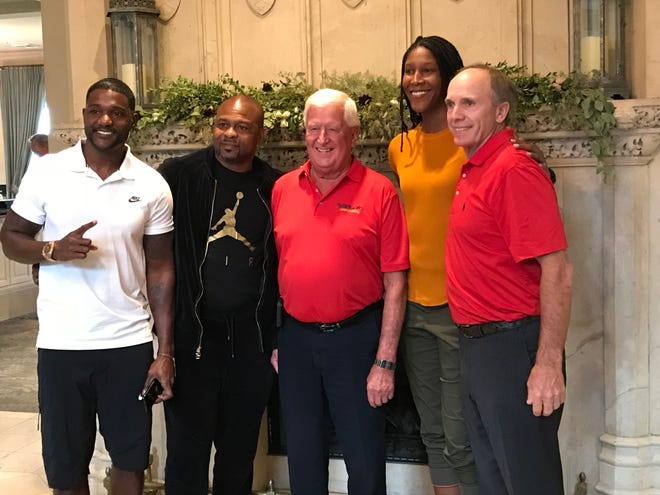 Four of Pensacola's greatest athletes, Justin Gatlin (far left), Roy Jones Jr, Michelle Snow and Jerry Pate gather with Gordon Sprague, local board member of the Florida Sports Hall of Fame during reception Tuesday at Pensacola Country Club.