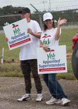 Michelle Salzman, a Yes for Escambia Schools political committee volunteer, reacts to voters approving a referendum to appoint school superintendents