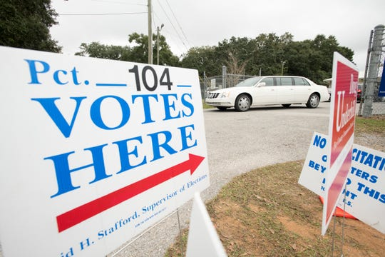 David Hawkins, owner of Joe Morris & Son Funeral Home, drives Mike Moreno home after the Pensacola man voted Tuesday at the Mayfair Community Center