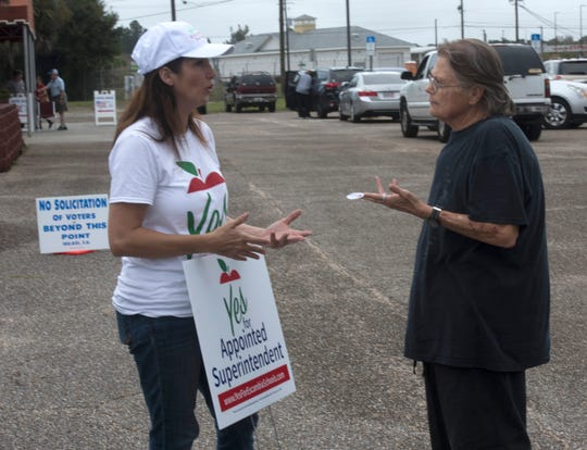 Michelle Salzman, a supporter of the appointed superintendent referendum, talks with a voter, Anna Cary,  at the Pensacola Interstate Fairground voting precincts on Tuesday, Nov. 6, 2018.