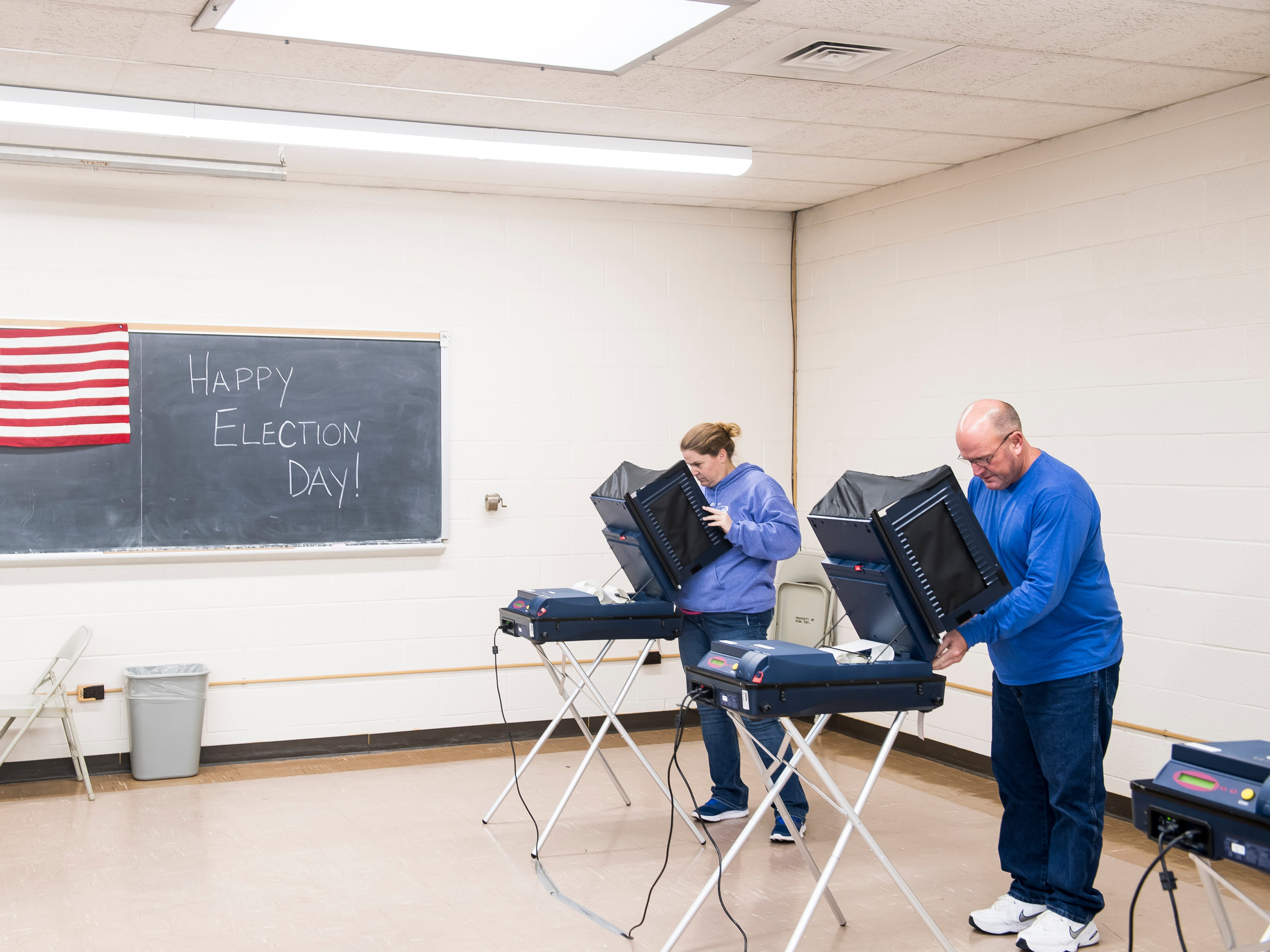 Christy and Brad Hill cast their ballots at the Penn Township Municipal Building polling venue on Tuesday, November 6, 2018.