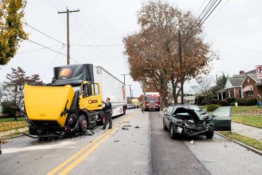 Police and fire personnel work the scene of a two-vehicle crash on Broadway in Hanover Borough on Tuesday, November 6, 2018.