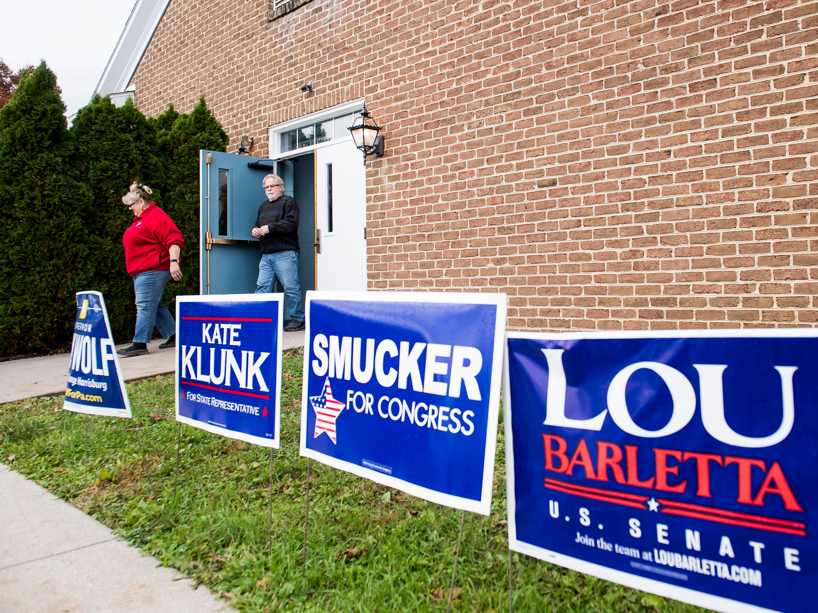 Campaign signs line a sidewalk outside a polling station at Grace United Methodist Church in Penn Township on Tuesday, November 6, 2018.