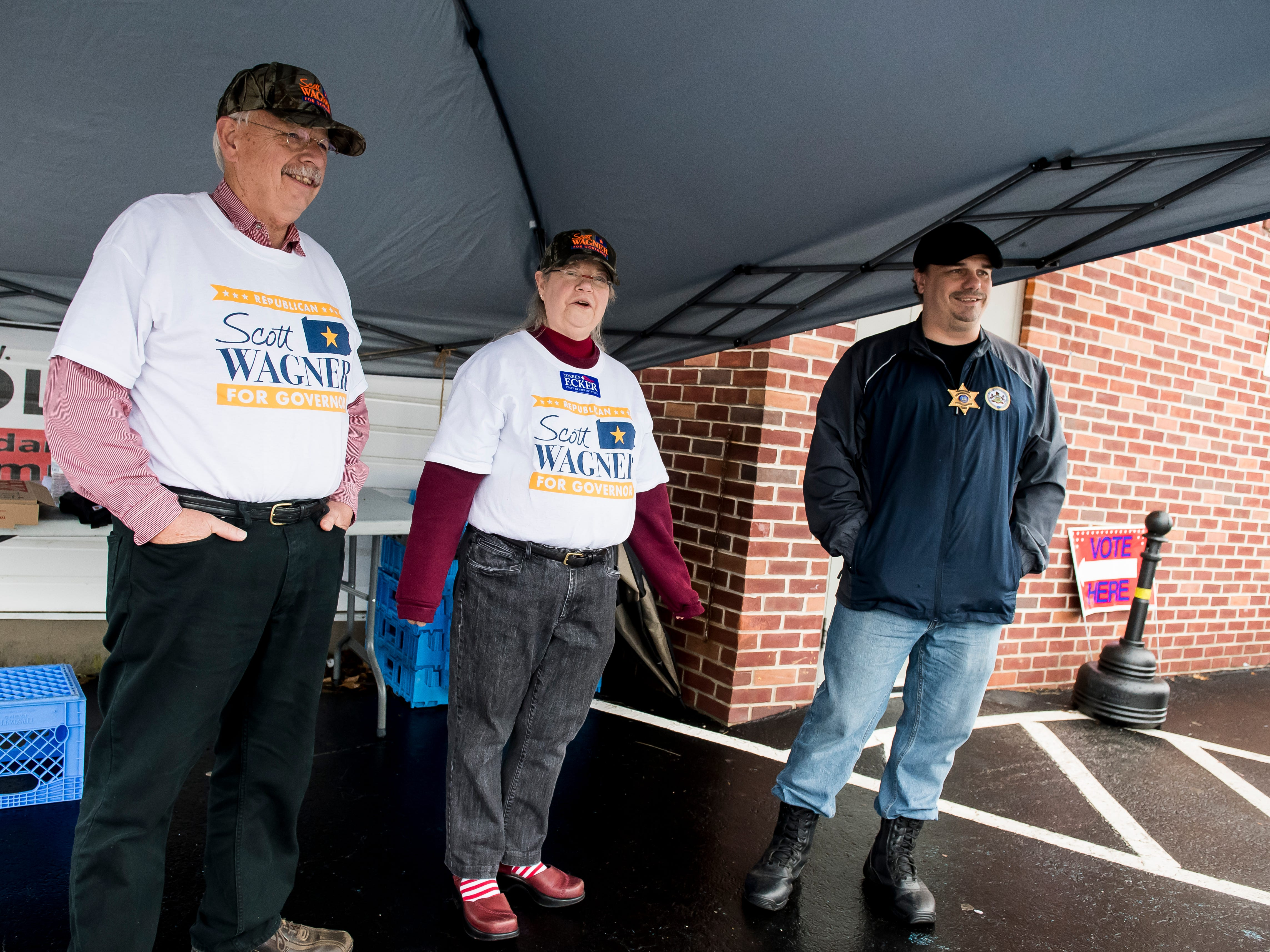 (From left) Perry Shearer, Debbie Shearer and David Bolton stand outside a polling station at the Knights of Columbus in McSherrystown on Tuesday, November 6, 2018..