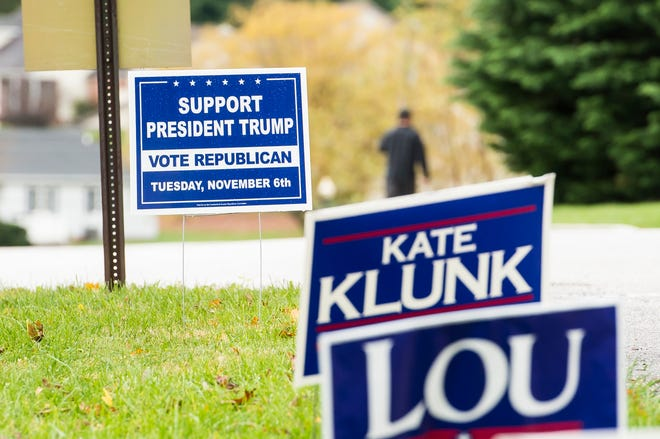 Campaign signs line an area outside a polling station at Grace United Methodist Church in Penn Township on Tuesday, November 6, 2018.