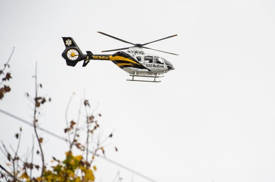 A STAT MedEvac helicopter prepares to land in a grassy field off Fame Avenue near Hanover Middle School on Tuesday, November 6, 2018.