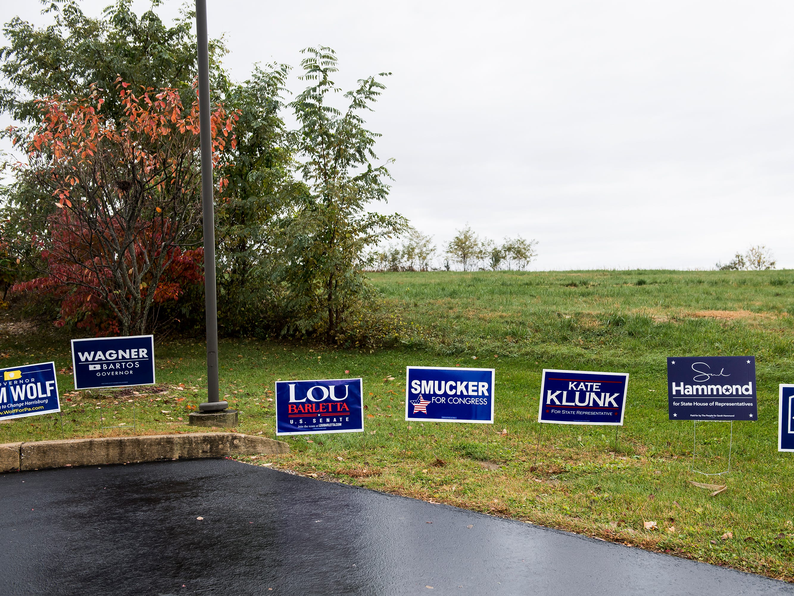 Campaign signs line a grassy area near the entrance to a polling station at Penn Township Volunteer Emergency Services on Tuesday, November 6, 2018.