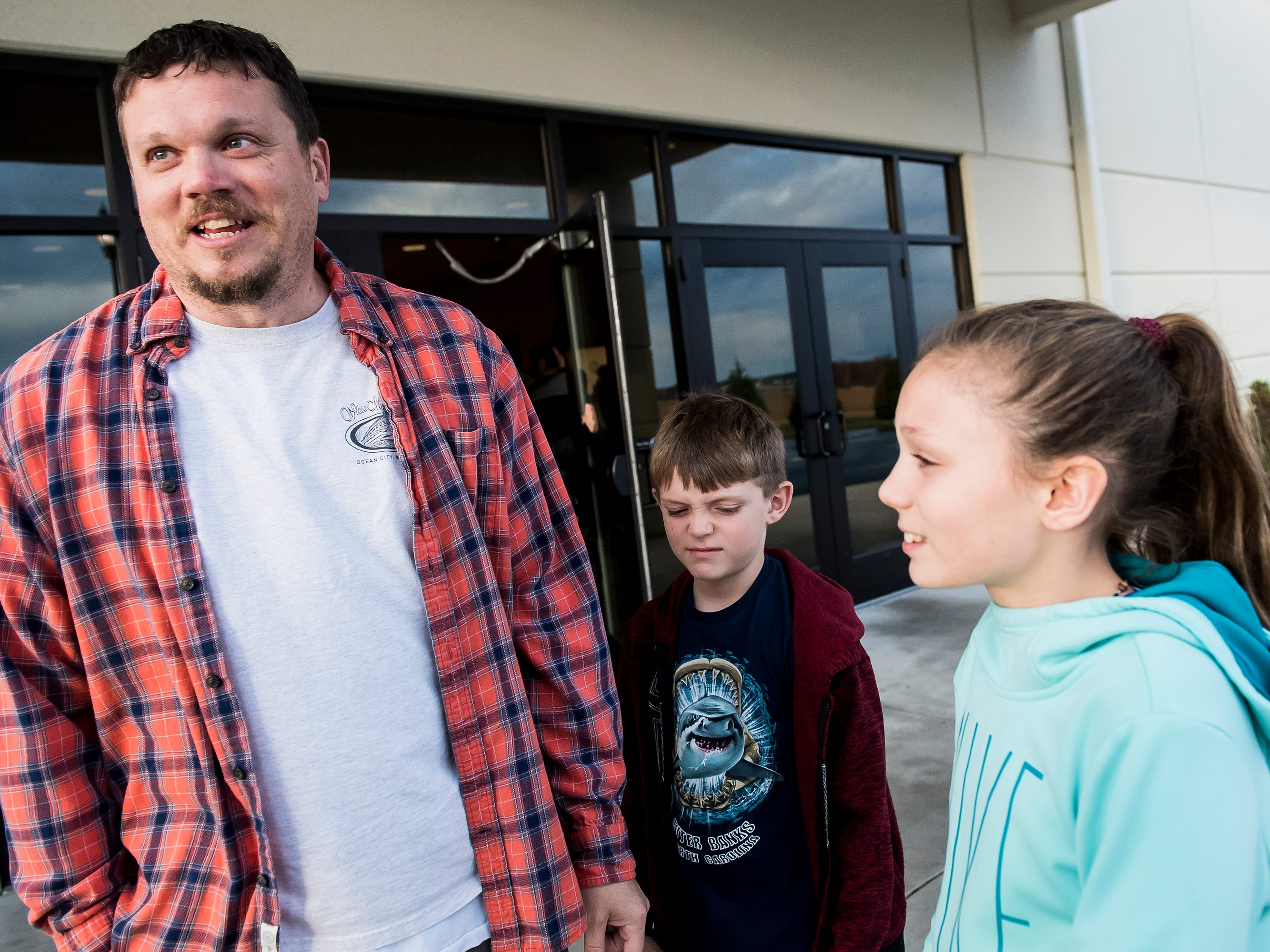 Siblings Lucy Laughlin, 10, and Eli Laughlin, 7, stand next to their dad, Billy Laughlin, after visiting a polling station at the Southeastern Adams Volunteer Emergency Services building in Conewago Township on Tuesday, November 6, 2018.