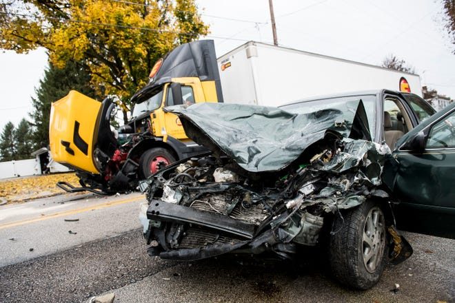 The scene of a two-vehicle crash in the 1100 block of Broadway in Hanover on Tuesday, November 6, 2018. The green Toyota Camry struck the tractor trailer head on, according to Hanover Area Fire and Rescue Chief Tony Clousher.