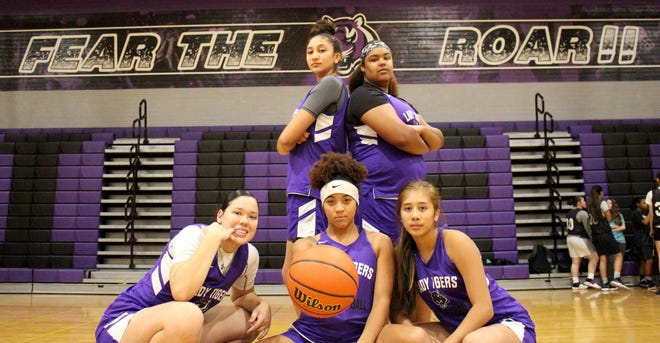The top players from Millennium's girls basketball team pose before a practice Monday.