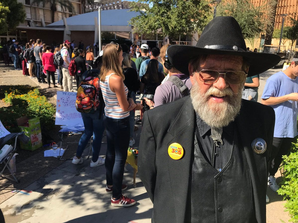 Bill Pierce, candidate for state mine inspector, was talking to voters outside a polling place at the ASU main campus in Tempe, Nov. 6, 2018.