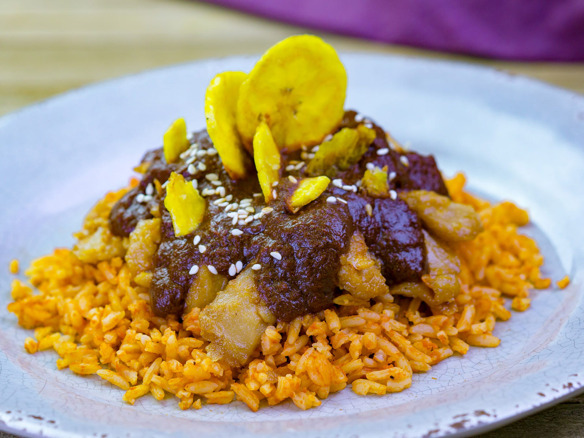 """Chicken-less"" mole with Spanish rice found at the A Twist on Tradition marketplace during Disney Festival of Holidays at Disney California Adventure Park. Guests can stroll through the Festive Foods Marketplace and enjoy a variety of holiday comfort dishes that span cultures and family traditions."