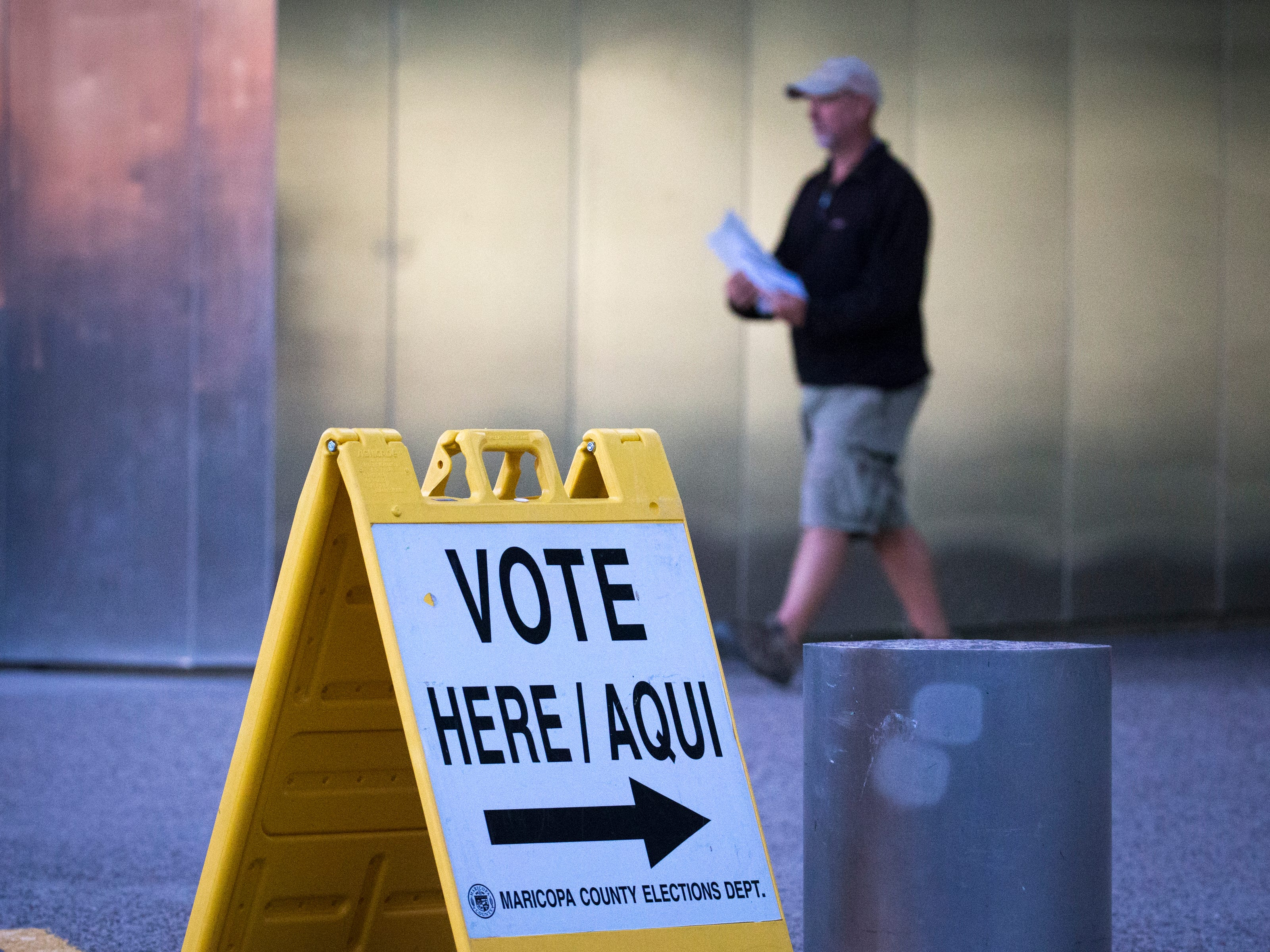 A voter leaves the polling place after casting his ballot, Nov. 6, 2018 at the Burton Barr Library, 1221 N. Central Ave. in Phoenix.