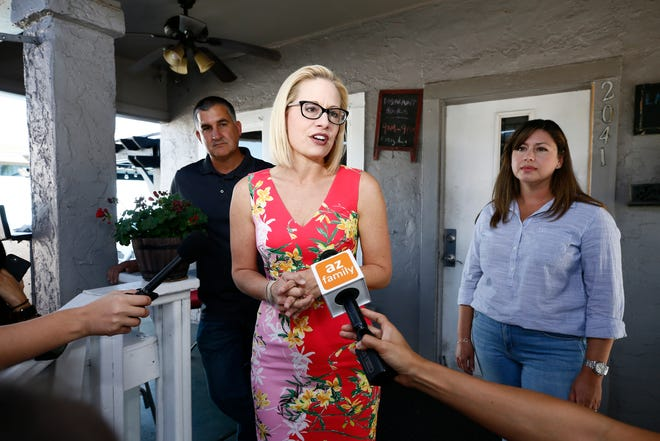 Rep. Kyrsten Sinema, D-Ariz., the Democratic candidate for the Arizona's U.S. Senate seat, talks to the media at America's Taco Shop on Nov. 6, 2018 in Phoenix.