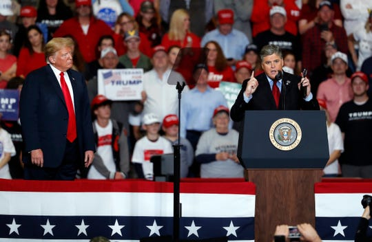 Fox News host Sean Hannity (right) speaks as President Donald Trump listens during a campaign rally Nov. 5, 2018, in Cape Girardeau, Missouri.