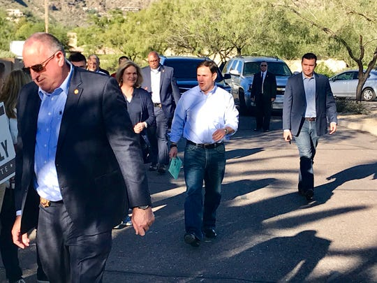 Gov. Doug Ducey heads to his polling place in Paradise Valley to drop off his ballot around 8:40 a.m., Nov. 6, 2018.