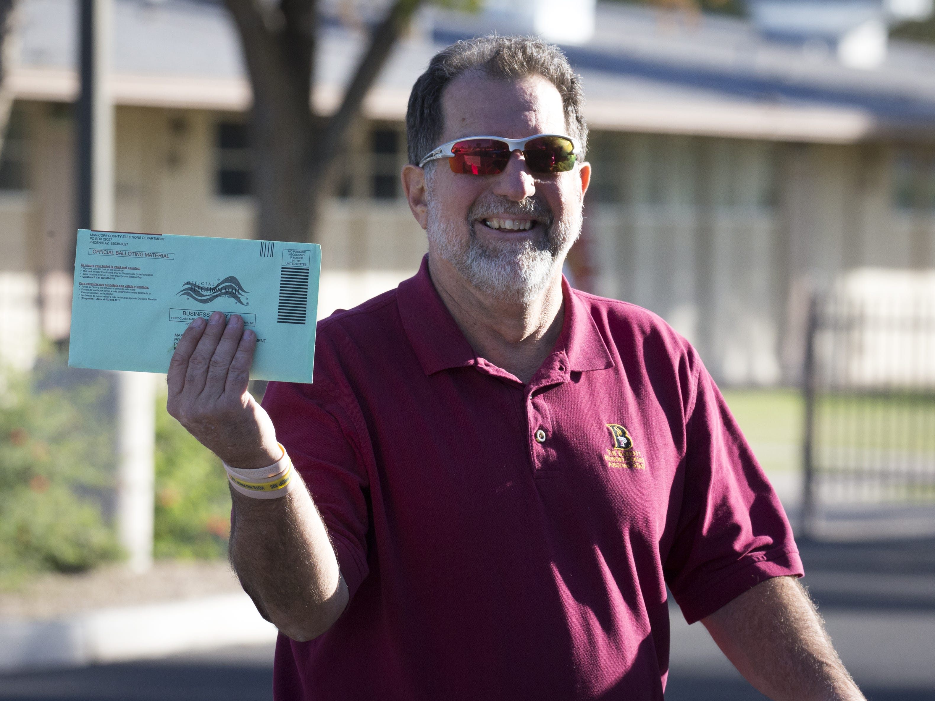 Kurt Goeing arrives to drop off his ballot, Nov. 6, 2018, at Glendale Elementary School District, 7301 N. 58th Ave. in Glendale.