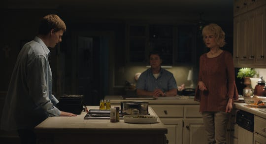"""Jared (Lucas Hedges, left) talks to his parents (Russell Crowe and Nicole Kidman) in """"Boy Erased."""""""