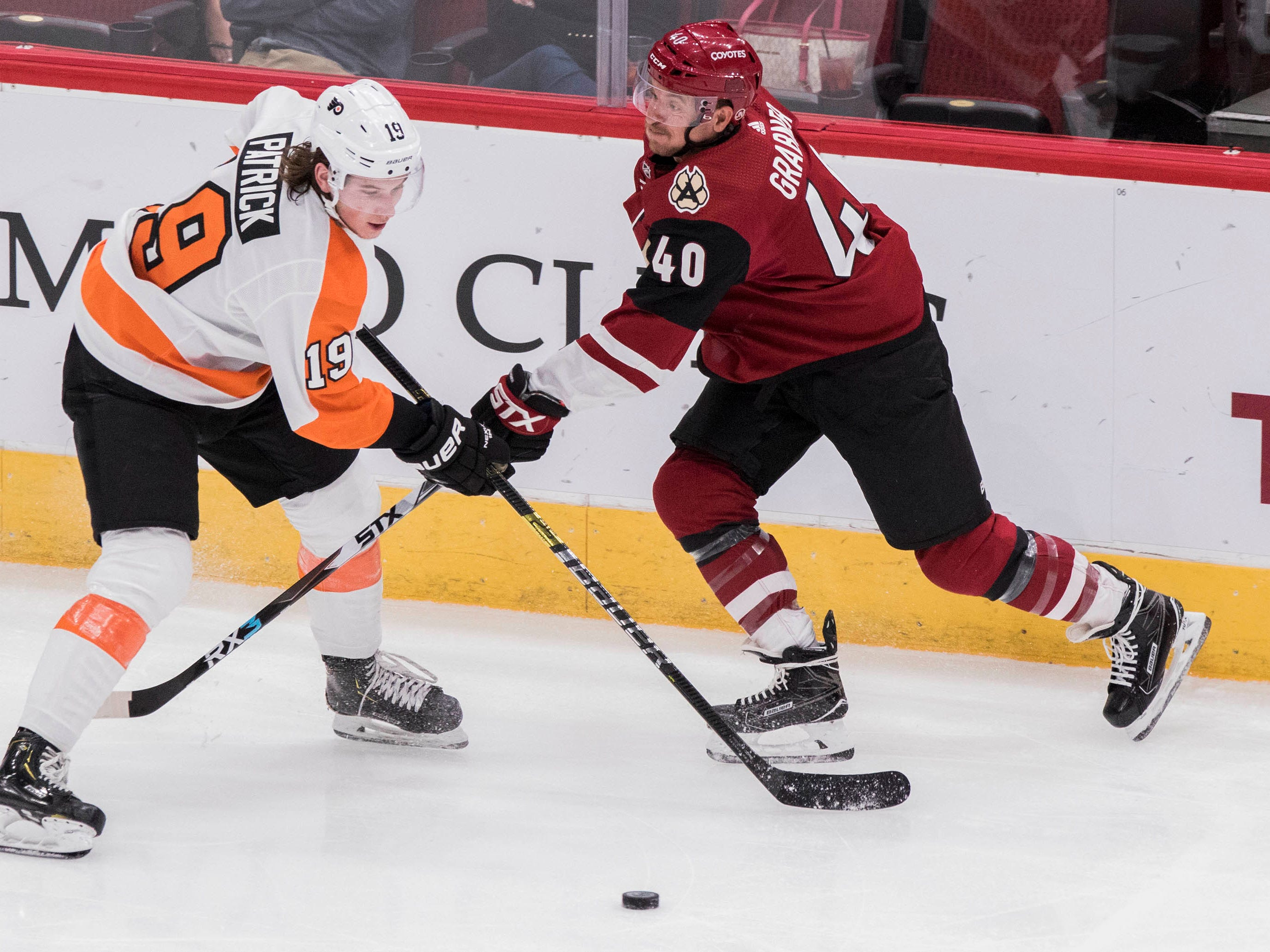 Arizona Coyotes' Michael Grabner (40) takes a shot against the Philadelphia Flyers' Nolan Patrick (19) during the second period of an NHL hockey game Monday, Nov. 5, 2018, in Glendale, Ariz. (AP Photo/Darryl Webb)