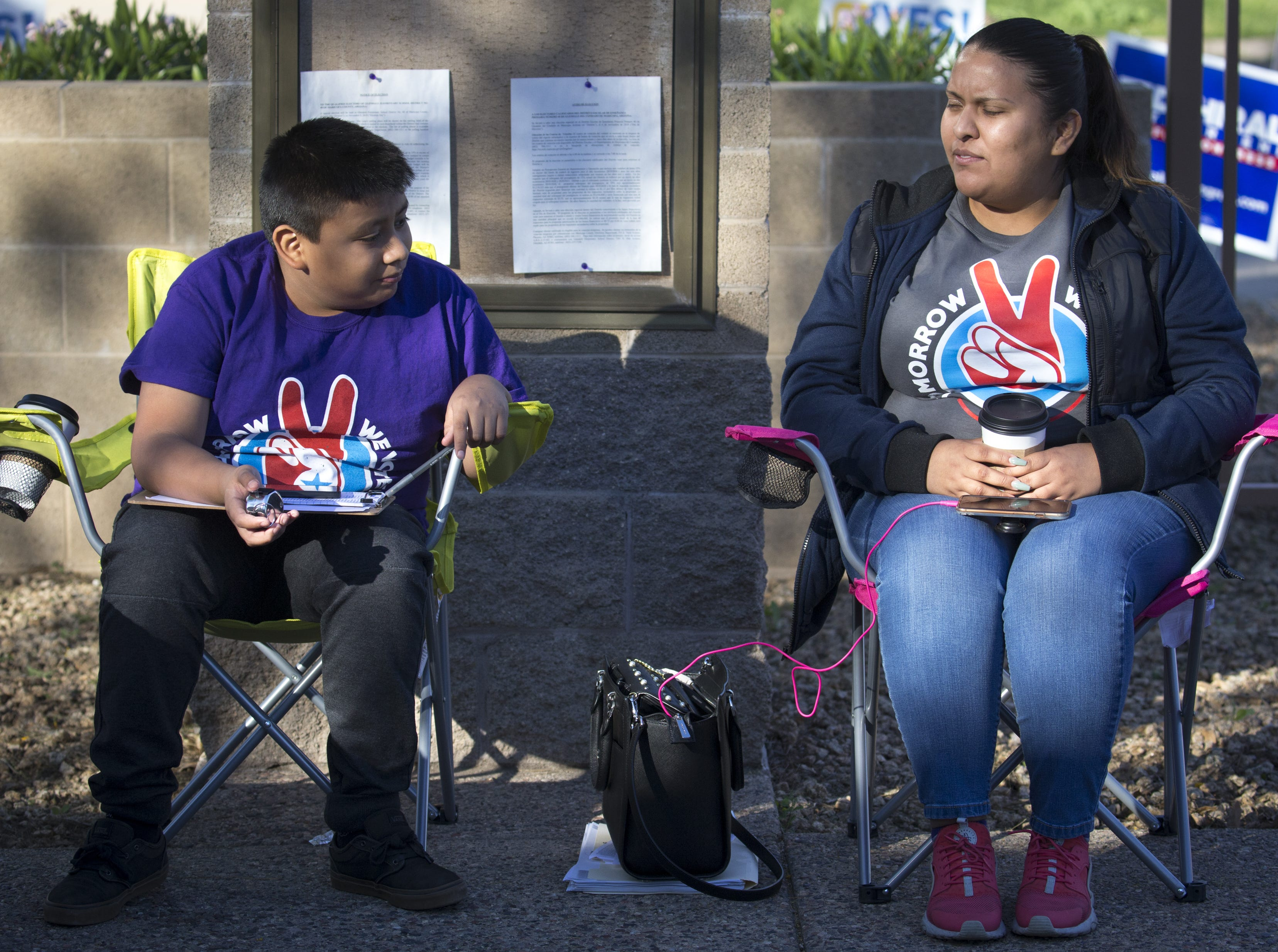 Jonathan Maldonado (left) and his sister, Yolanda Medina count voters as they arrive, Nov. 6, 2018, at Glendale Elementary School District, 7301 N. 58th Ave. in Glendale. Over 60 votes were cast at this poll before 9 a.m.