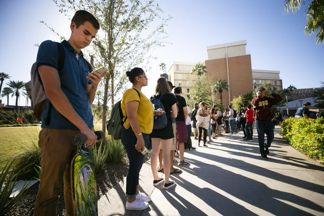 Arizona State University student Alex Riordan (left) and other ASU students wait in line to vote at the polling place at ASU's Tempe campus on Nov. 6, 2018. Riordan is a first time voter.