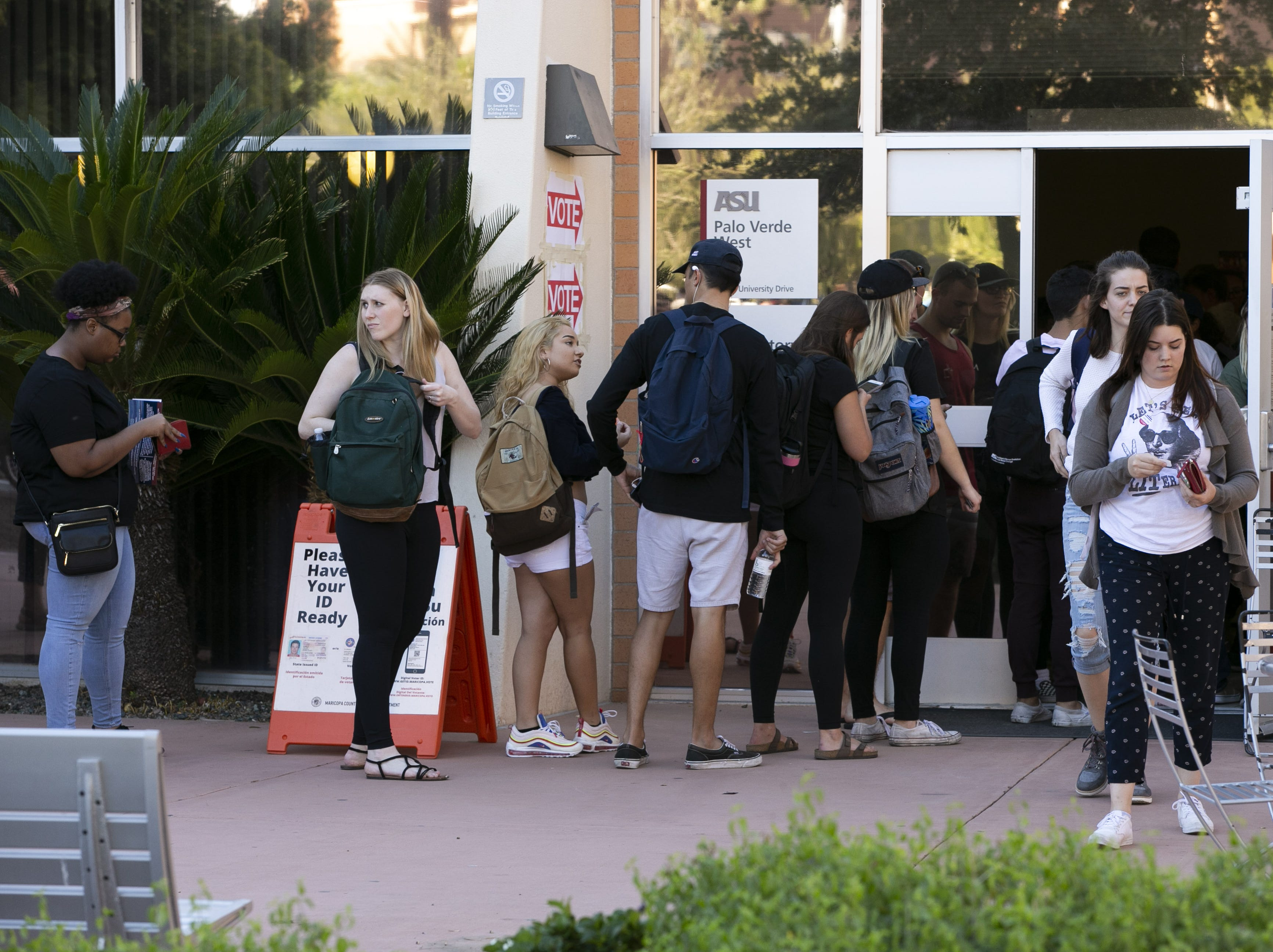 Arizona State University students wait in line to vote at the polling place at ASU's Tempe campus on Nov. 6, 2018.