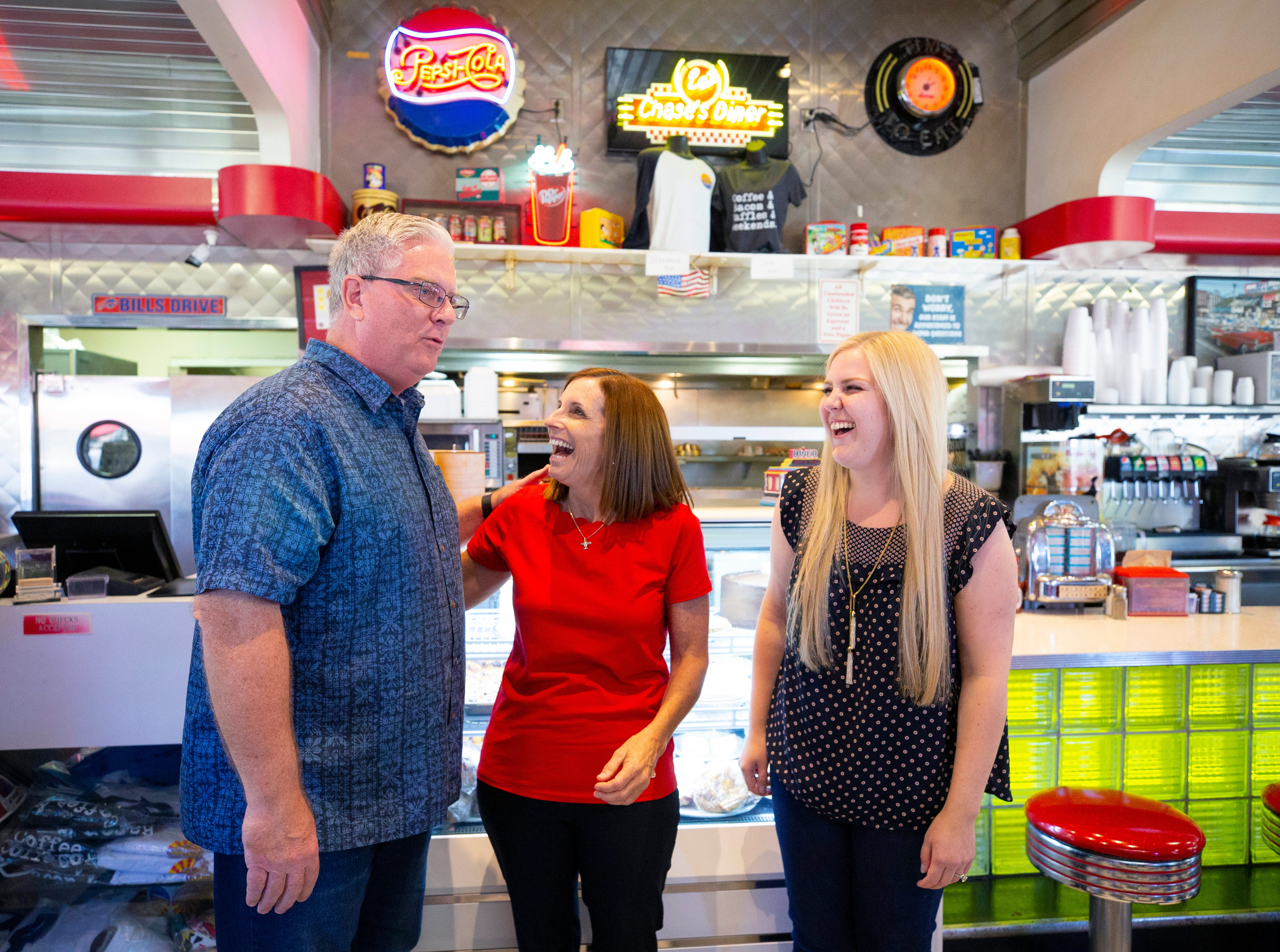 Skip Chase owner of Chase's Diner in Chandler and his daughter Jennifer, right, visits with Rep. Martha McSally on Election Day, Nov. 6, 2018.