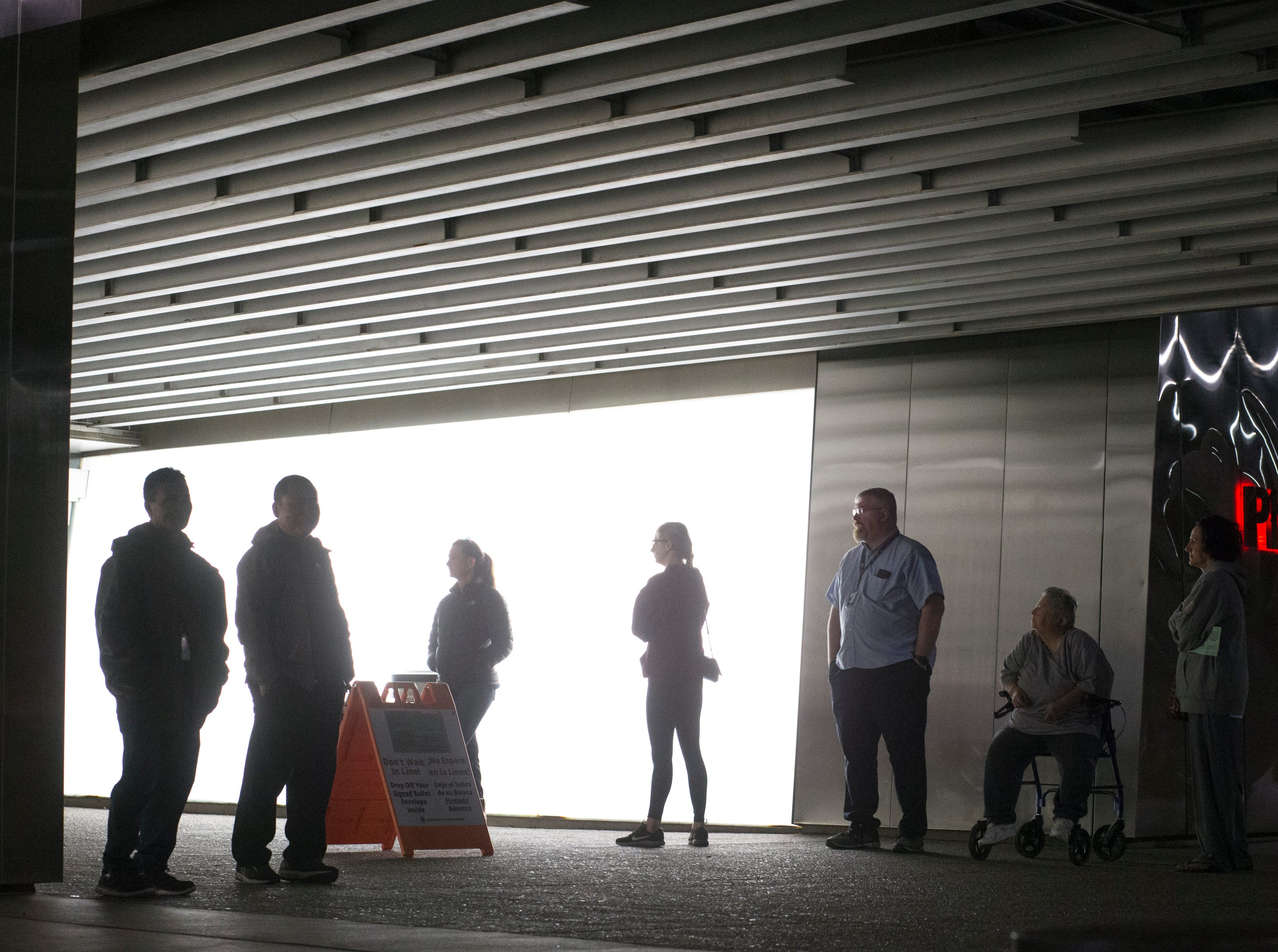 Voters wait for the polls to open, Nov. 6, 2018, at the Burton Barr Library, 1221 N. Central Ave. in Phoenix.