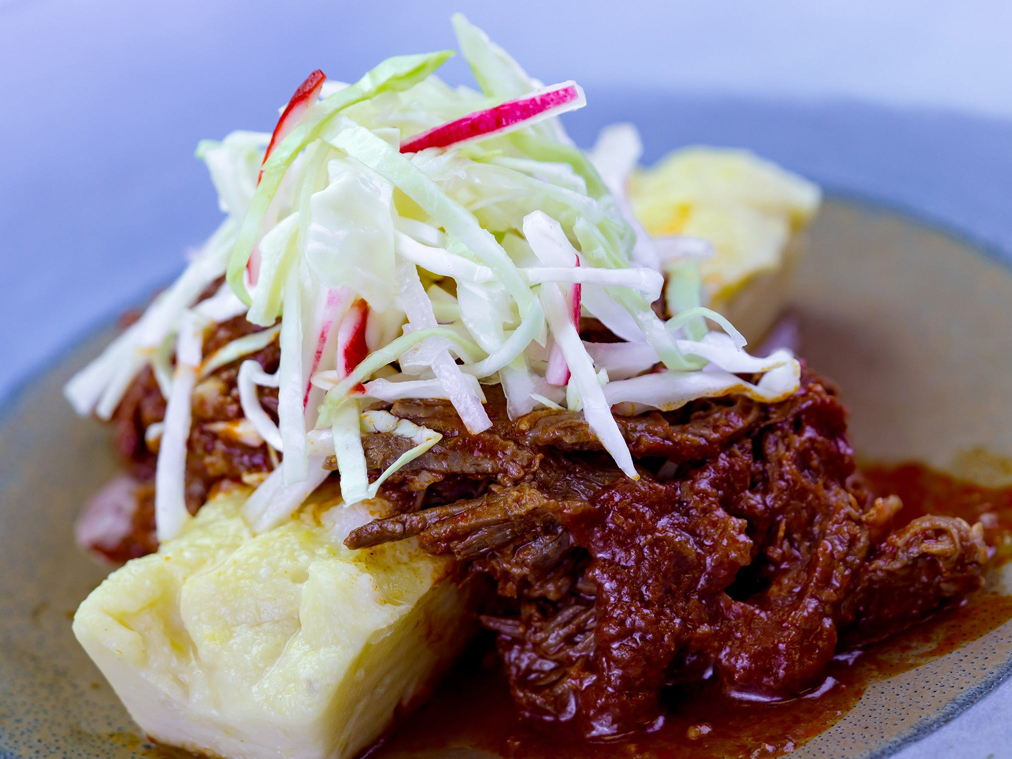 Pozole rojo beef with hominy polenta can be found at the A Twist on Tradition marketplace during Disney Festival of Holidays running Nov. 9-Jan. 8 at Disney California Adventure Park. Guests can stroll through the Festive Foods Marketplace and enjoy a variety of holiday comfort dishes that span cultures and family traditions.