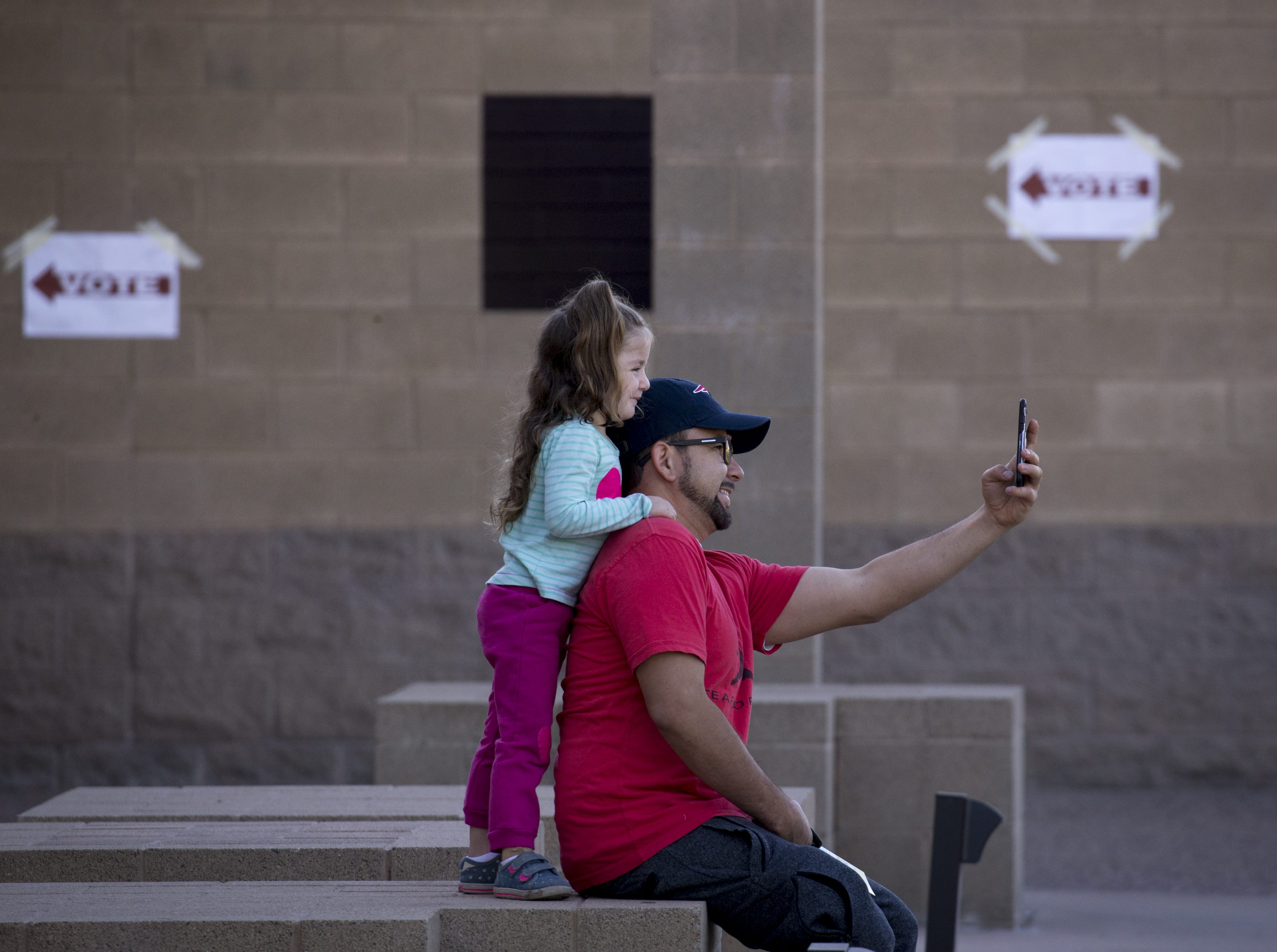 Michael Abril takes a selfie with his daughter, Hazel Abril, 3, before they go in for him to vote, Nov. 6, 2018, Glendale Elementary School District, 7301 N. 58th Ave. in Glendale.