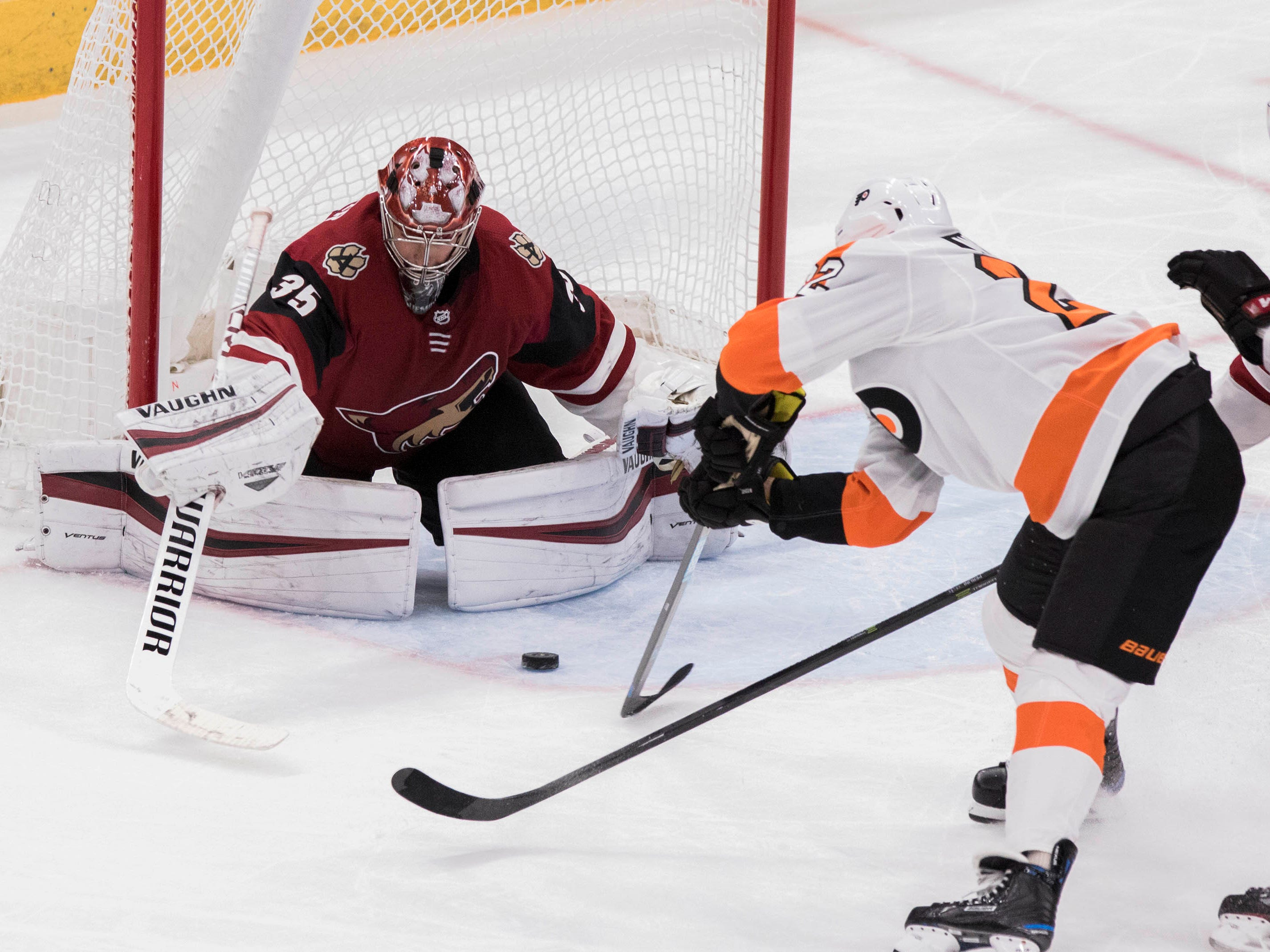 Arizona Coyotes goalie Darcy Kuemper (35) blocks a shot against the Philadelphia Flyers' Dale Weise (22) during the third period of an NHL hockey game, Monday, Nov. 5, 2018, in Glendale, Ariz. (AP Photo/Darryl Webb)