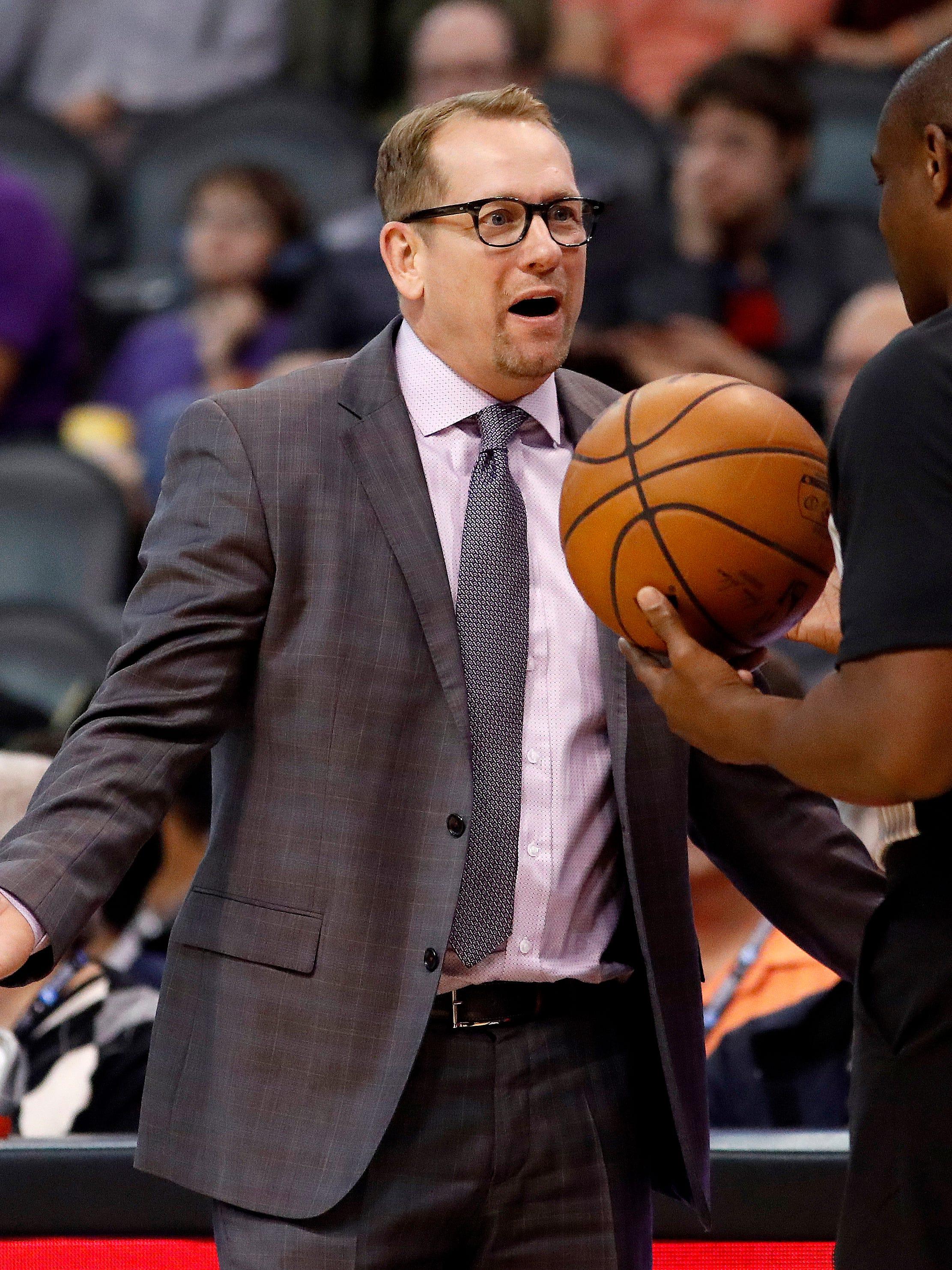 Toronto Raptors head coach Nick Nurse talks with referee Tony Brown (6) during the second half of an NBA basketball game against the Phoenix Suns, Friday, Nov. 2, 2018, in Phoenix. (AP Photo/Matt York)