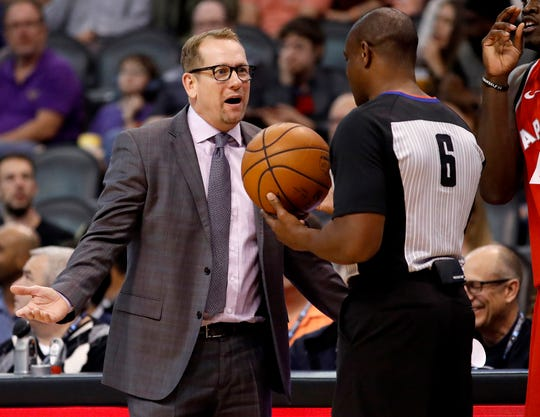 Raptors coach Nick Nurse talks with referee Tony Brown during the second half of a game against the Suns on Nov. 2 at Talking Stick Resort Arena.